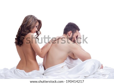 Beautiful naked girl soothes frustrated lover - stock photo