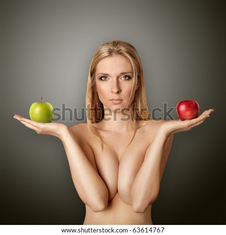 beautiful naked woman with apples looking at camera, with open hands - stock photo