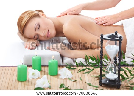 beautiful naked young woman getting back massage at spa - stock photo