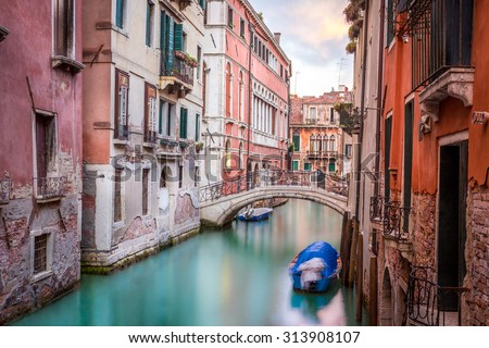 Beautiful narrow canal with silky water in Venice, Italy - stock photo