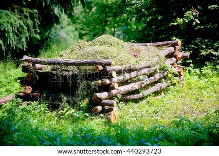beautiful natural compost heap in woodland permaculture garden - stock photo