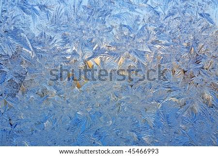 Beautiful natural frosty pattern on winter window. - stock photo