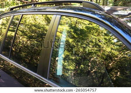 Beautiful natural scene reflected on the car. - stock photo