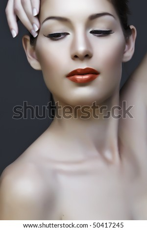 beautiful natural woman with false lashes and classic make-up with coral lipstick - stock photo