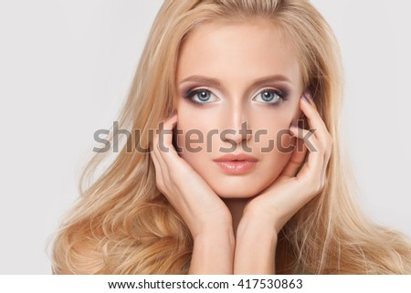 Beautiful natural woman with fashion make-up and blonde hair, portrait of an young girl isolated on white - stock photo