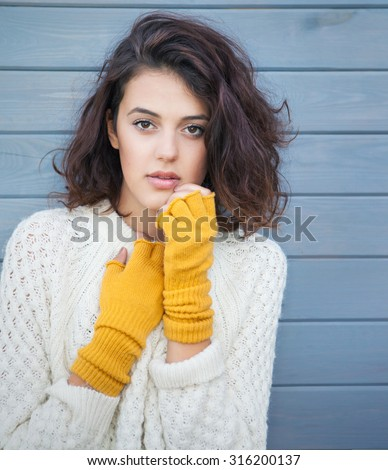 Beautiful natural young brunette woman wearing knitted sweater and gloves. Fall and winter fashion concept. - stock photo