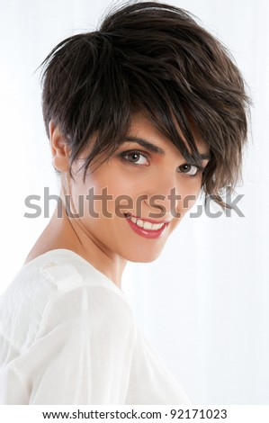 Beautiful natural young lady smiling in bright light - stock photo
