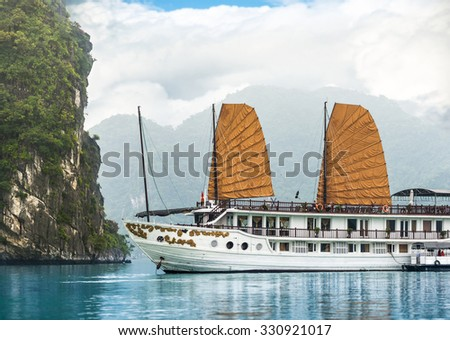 Beautiful nature in Halong bay, Vietnam, Asia. Picturesque scene with blue sky, ripple on water and mountains. Houseboat. Idea of recreational tourism. Tranquil view of seascape. - stock photo