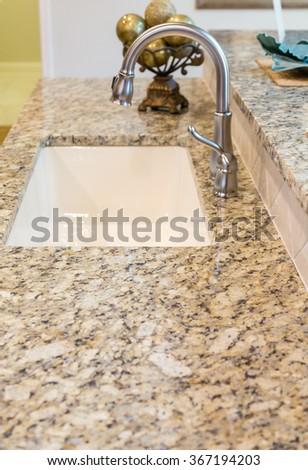Beautiful new granite countertops in a kitchen - stock photo