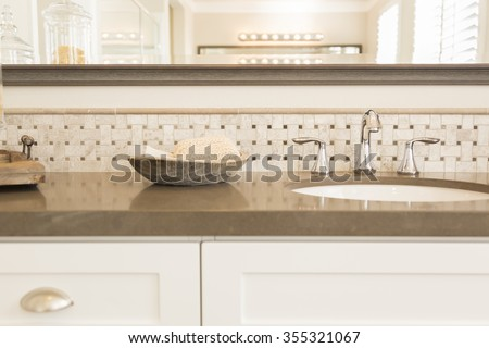 Beautiful New Modern Bathroom Sink, Faucet, Subway Tiles and Counter.  - stock photo
