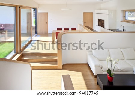 Beautiful new peaceful, modern living room with kitchen - stock photo
