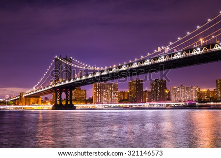 Beautiful  New York City view of the The Manhattan Bridge looking towards Manhattan from Brooklyn at night - stock photo