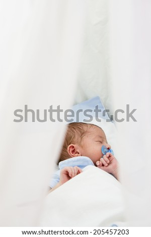 Beautiful Newborn baby sleeping Under Soft Blanket - stock photo