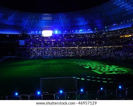 Beautiful night football stadium and light rays - stock photo