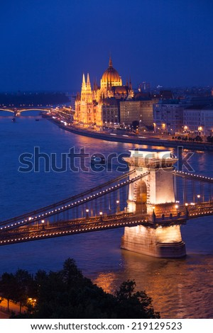 Beautiful night panorama view of Chain Bridge and parliament with lights in Budapest, Hungary - stock photo