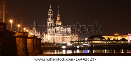 Beautiful night scene in Dresden, Germany on the river Elbe. Image shows the Catholic Church of the Royal Court of Saxony St. Trinitatis, the Frauenkirche church and the old town sector. - stock photo