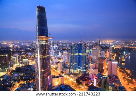 Beautiful night sightseeing in HO CHI MINH, VIETNAM on AUGUST 14, 2014 : Colorful Saigon by Night at downtown riverside Ho Chi Minh City with buildings, lights and traffics view from the high. - stock photo
