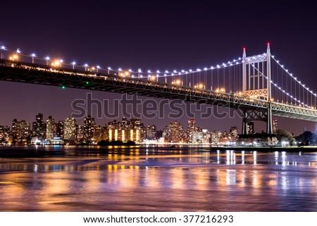 Beautiful night view of New York City and the 59th Street Ed Koch Bridge looking across to Manhattan. - stock photo
