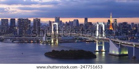 Beautiful night view of Tokyo Bay , Rainbow bridge and Tokyo Tower landmark  - stock photo