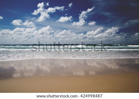 beautiful noon seaside landscape with white foamy waves, beach, Pacific ocean, Gold Coast, Queensland, Australia. Matte effect - stock photo