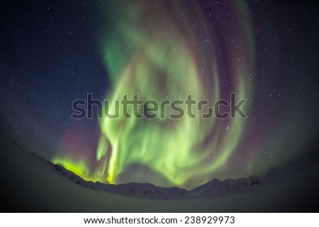 Beautiful Northern Lights over the Arctic mountains and glaciers - stock photo
