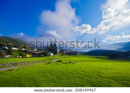 Beautiful norwegian village Roldal with scandinavian cottages, mountains and lake, summer in Norway  - stock photo
