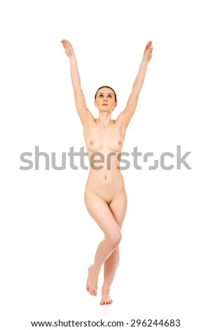 Beautiful nude woman in drawing pose with her hands up. - stock photo