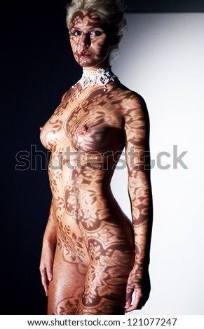 Beautiful Nude Woman's Sensual Body in Shadows blinds - Lace Tracery - stock photo