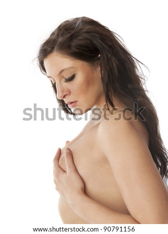 Beautiful nude woman self examining her breasts for lumps on white background - stock photo