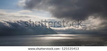 Beautiful ocean scenery with clouds, Faeroe Islands, North Atlantic - stock photo