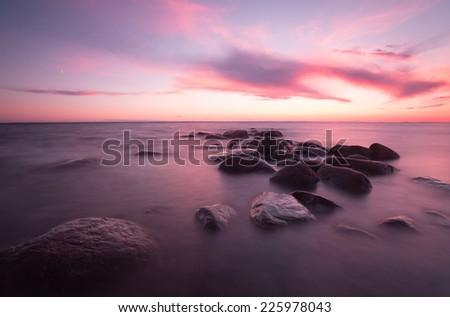 Beautiful ocean sunsetting, Swedish coastline - stock photo