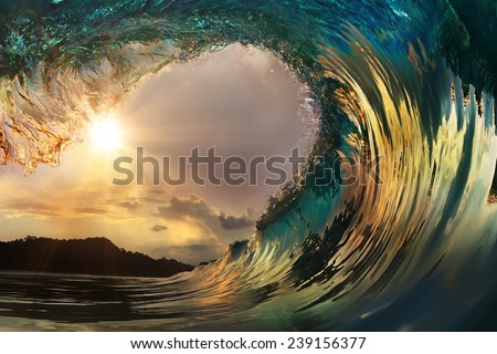Beautiful ocean surfing wave at sunset beach - stock photo