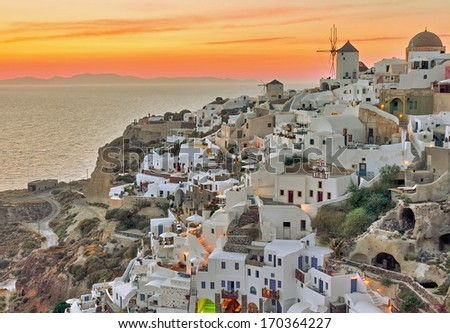 Beautiful Oia village sunset in Santorini island Greece photographed from a high point of view in high dynamic range (HDR)  - stock photo