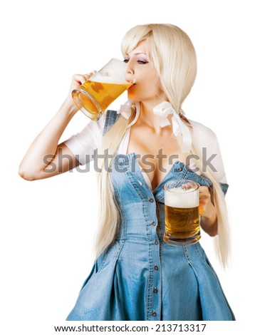 Beautiful oktoberfest young sexy woman wearing a dirndl with two froth beer mugs drink beer from mug isolated on white background - stock photo