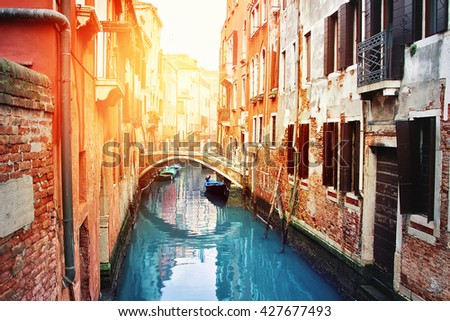 Beautiful old canal in Venice, Italy. Romantic atmosphere. Venice is historical Italian place. - stock photo
