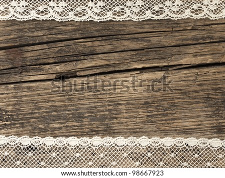 beautiful old fashion lace on the wooden background - stock photo