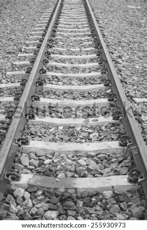 Beautiful old forgotten steel railway in black and white photo - stock photo