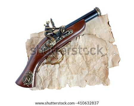 Beautiful old musket or pistol and paper isolated on white background - stock photo
