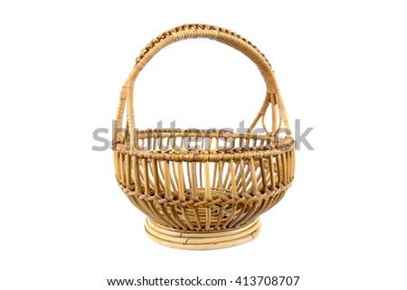 Beautiful old round rattan basket isolated on white background - stock photo