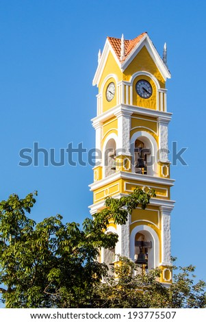 Beautiful old Spanish church and bell tower near Playa del Carmen, Mexico - stock photo