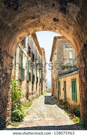Beautiful old street in Tuscany, Italy - stock photo