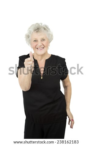 Beautiful old woman doing a thumb up gesture against a white background - stock photo