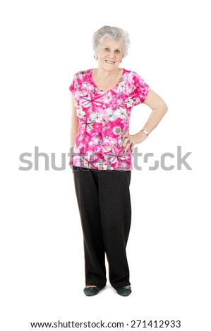 Beautiful old woman standing against a white background - stock photo