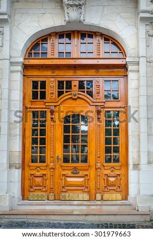 Beautiful old wooden door in Lviv. - stock photo