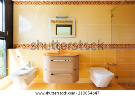 beautiful orange bathroom - stock photo