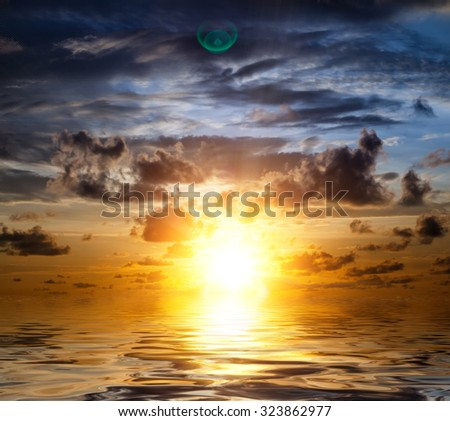 Beautiful orange sunrise in the Indian Ocean - stock photo