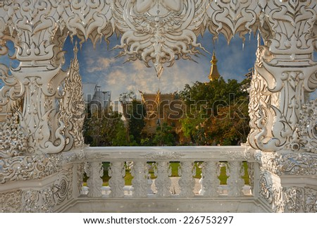 Beautiful ornate white temple located in Chiang Rai northern Thailand. Wat Rong Khun (White Temple), is a contemporary unconventional Buddhist temple.Buddhist and Hindu motifs. - stock photo