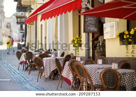 Beautiful outdoor restaurant in Vilnius on beautiful summer day - stock photo