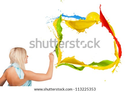 Beautiful paintress painting colored splashes frame, isolated on white background - stock photo