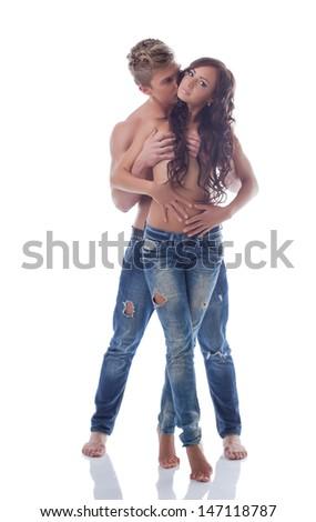 Beautiful pair of sexual partners posing in studio - stock photo